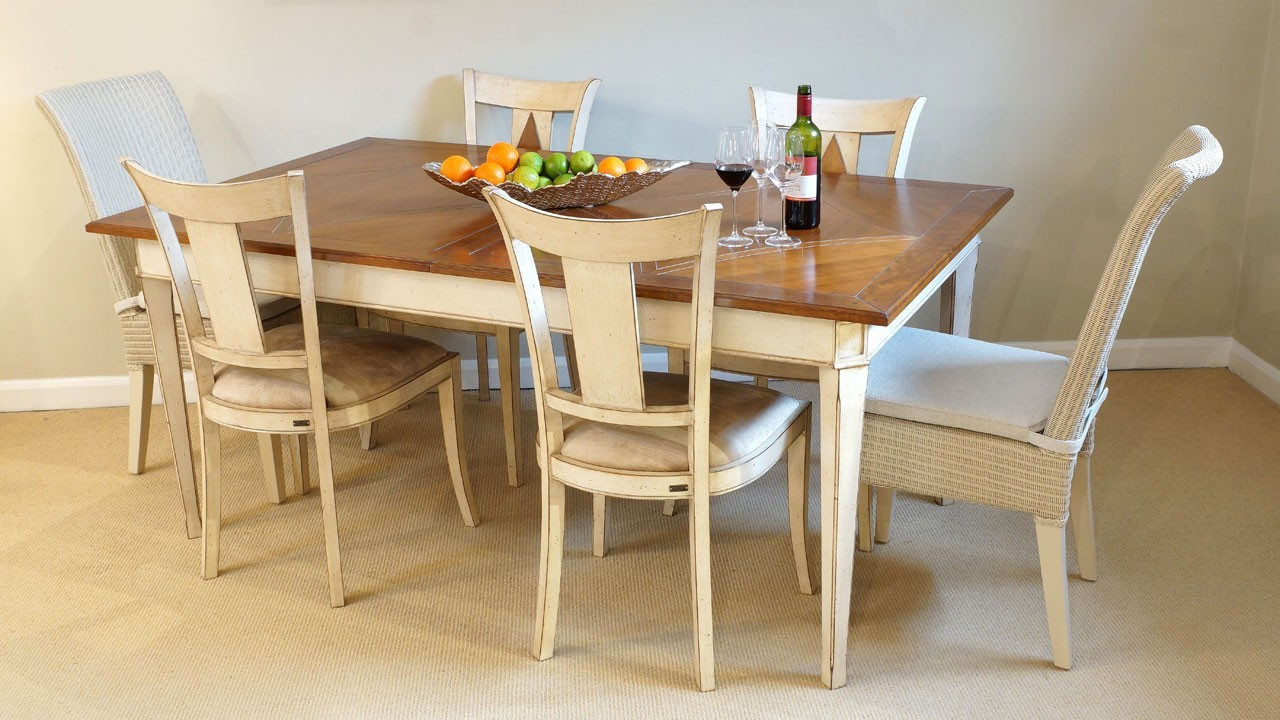 Carte Blanche Dining Table - Angled View with Chairs